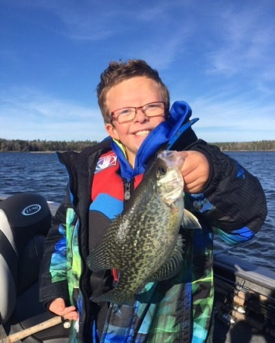 child holding up fish